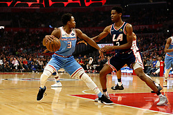 January 27, 2019 - Los Angeles, CA, U.S. - LOS ANGELES, CA - JANUARY 27: Sacramento Kings guard Yogi Ferrell (3) attempts to dribble past Los Angeles Clippers guard Shai Gilgeous-Alexander (2) during the game against the Los Angeles Clippers on January 27, 2019, at Staples Center in Los Angeles, CA. (Photo by Adam  Davis/Icon Sportswire) (Credit Image: © Adam Davis/Icon SMI via ZUMA Press)
