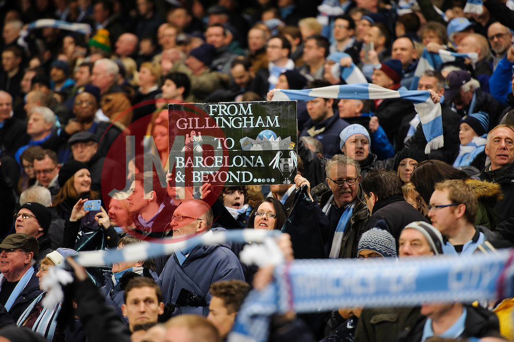 Man City city fans hold up signs and flags before the game - Photo mandatory by-line: Rogan Thomson/JMP - Tel: 07966 386802 - 18/02/2014 - SPORT - FOOTBALL - Etihad Stadium, Manchester - Manchester City v Barcelona - UEFA Champions League, Round of 16, First leg.
