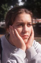 Portrait of teenage girl looking unhappy,