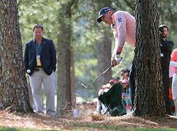 April 6, 2018 - Augusta, GA, USA - Matt Kuchar hits out of the woods off of the first fairway during the second round of the Masters at Augusta National Golf Club on Friday, April 6, 2018, in Augusta, Ga. (Credit Image: © Jason Getz/TNS via ZUMA Wire)