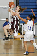 Kingston's Tracy Weber, left, leaps to the basket as Middletown's Taj Anthony defends during a game in Middletown on Feb. 15, 2008.