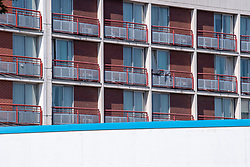 """© Licensed to London News Pictures. 19/07/2021. London, UK. A general exterior view of the Crowne Plaza hotel in West Drayton. London's Metropolitan Police Service (MPS) were notified by the London Ambulance Service (LAS) shortly before 01:00BST on Sunday 18/07/2021 to reports of a person deceased at asylum accommodation at the Crowne Plaza hotel in Stockley Road, West Drayton. A man in his 20's, who is believed to be a Sudanese asylum seeker, was pronounced dead at the scene. A Home Office Spokesperson said: """"At this stage, the death is being treated as unexplained."""" Photo credit: Peter Manning/LNP"""