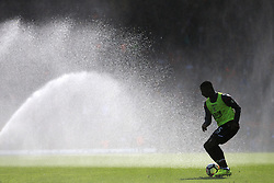 19th August 2017 - Premier League - Liverpool v Crystal Palace - Sullay Kaikai of Palace silhouetted as he warms up under the water sprinklers - Photo: Simon Stacpoole / Offside.