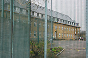 The fence around C wing at HMP Downview, Surrey, United Kingdom. HMP Downview is a women's closed category prison for adult sentenced women and convicted and remand female young people located on the outskirts of Banstead in Surrey, England. (Picture credit: © Andy Aitchison)