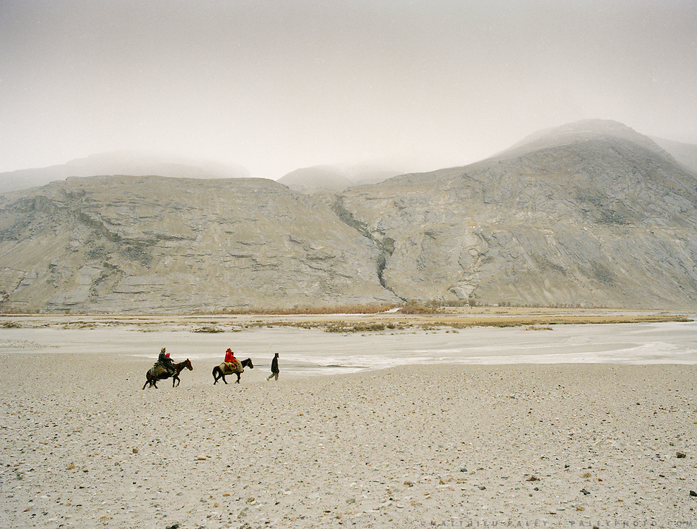 Wakhi traveling on horse back through teh Wakhan Corridor, near Qala-e Pinja.