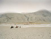 Wakhi traveling on horse back through teh Wakhan Corridor, near Qala-e Pinja.