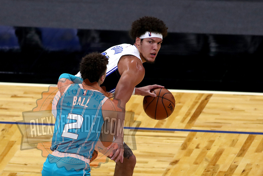 ORLANDO, FL - DECEMBER 17:  Aaron Gordon #00 of the Orlando Magic dribbles in front of LaMelo Ball #2 of the Charlotte Hornetsat Amway Center on December 17, 2020 in Orlando, Florida. NOTE TO USER: User expressly acknowledges and agrees that, by downloading and or using this photograph, User is consenting to the terms and conditions of the Getty Images License Agreement. (Photo by Alex Menendez/Getty Images)