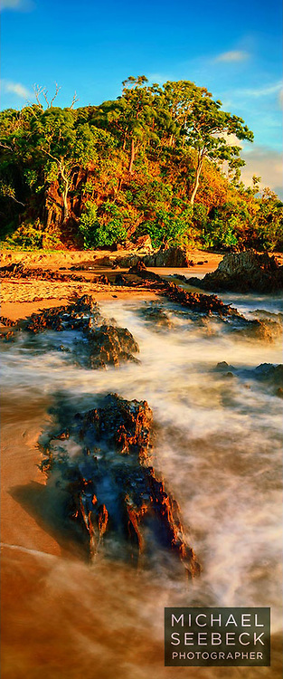Early morning waves wash over rocks near the headland at Palm Cove. <br /> <br /> This headland is for sale and its pristine state will be destroyed by development.<br /> <br /> Code: XAQT0001<br /> <br /> Limited Edition of 125