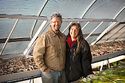 Shari Sirkin and Bryan Dickenson inside green house.