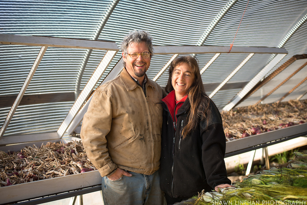 Shari Sirkin and Bryan Dickenson inside green house.