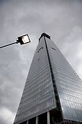 The Shard under construction on a grey day. This glass skyscraper reflects it's ssurroundings and here makes a scene devoid of colour. The Shard (aka The Shard of Glass) is being built on the south side of the city near London Bridge. Shard London Bridge, previously known as London Bridge Tower, and also known as the Shard of Glass. The Shard is a supertall skyscraper under construction in Southwark. When completed in 2012 it will be the tallest building in the European Union. The tower will stand at 310 m (1,017 ft) tall and have 72 floors, plus 15 further floors in the roof. Renzo Piano, the building's architect, worked together with architectural firm Broadway Malyan during the planning stage of the project. After a lengthy public inquiry, the collaboration successfully achieved its objective, and the developers were granted full planning permission in November 2003.