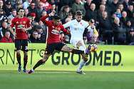 Marcos Rojo of Manchester Utd (l) challenges Fernando Llorente of Swansea city. Premier league match, Swansea city v Manchester Utd at the Liberty Stadium in Swansea, South Wales on Sunday 6th November 2016.<br /> pic by  Andrew Orchard, Andrew Orchard sports photography.
