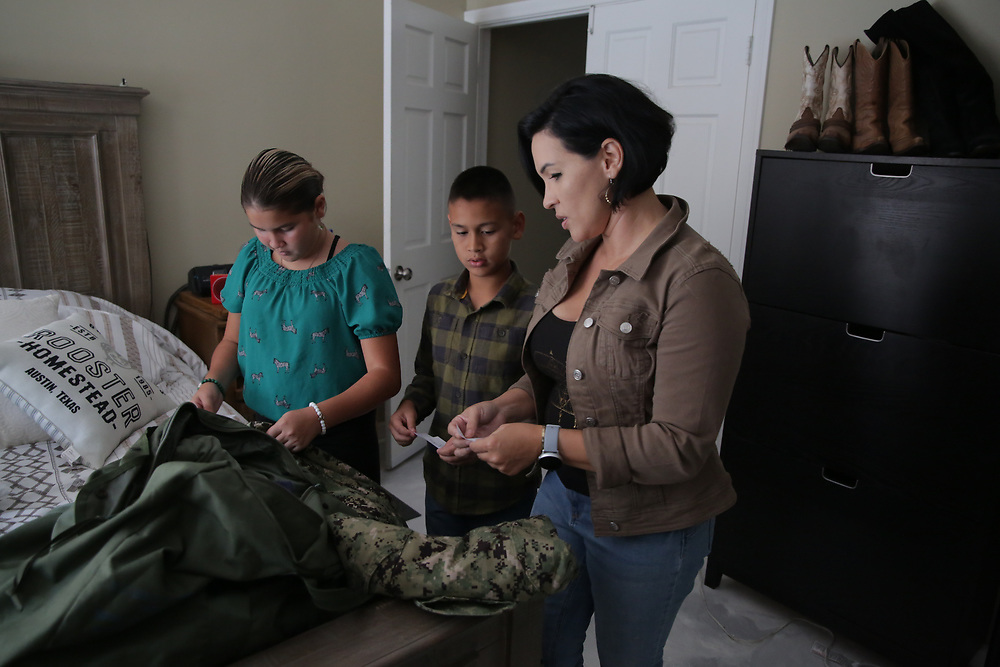 CHULA VISTA, CA SEPT 18:  Juan Garcia, a Navy Hospital Corpsman, SITS with his Wife Amanda and kids Ava(12) and Adonis(10)  outside of their home in Chula Vista, CA on Saturday, September 18, 2021.(Sandy Huffaker/Getty Images for Scholastic)