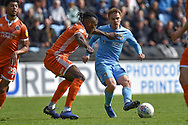 Coventry City midfielder (on loan from Derby County Luke Thomas (23) looks to release the ball under pressure from Shrewsbury Town defender Omar Beckles (6) during the EFL Sky Bet League 1 match between Coventry City and Shrewsbury Town at the Ricoh Arena, Coventry, England on 28 April 2019.