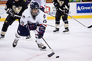 October 13, 2007 - Anchorage, Alaska: Brett Hopfe (15) of the Robert Morris Colonials controls the puck in the Colonials 4-1 victory over the Wayne State Warriors at the Nye Frontier Classic at the Sullivan Arena.