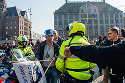 March 30, 2019 - Amsterdam, North Holland, Netherlands - Michael Jacobs an Israeli Dutch activist is seen clashing during the commemoration..Hundreds of people gathered in solidarity with Palestine to commemorate the Day of the Land by all Palestinians around the world. During the event some Israeli supporters showed up and there were clashes between the two sides. Dutch police intervened to calm the situation, Amsterdam. (Credit Image: © Ana Fernandez/SOPA Images via ZUMA Wire)