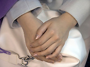 close up of folded Asian woman hands