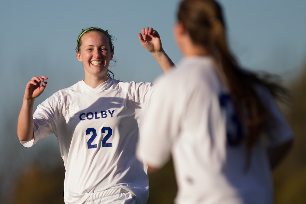 Lauren McCarthy and Hallie Hesslein, of Colby College, celebrate Hesslein's goal in a NCAA Division III soccer game against Husson University on October 9, 2013 in Waterville, ME. (Dustin Satloff/Colby College Athletics)