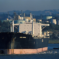 USA, California, Tugboats maneuver Oil tanker Arco Juneau from Arco facility in Martinez for return trip to Alaska