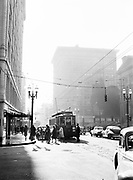"9969-7187. Street cars and people going to work at southwest Sixth and Morrison Street, Portland, Oregon. (""Portland Morning""). April 8, 1948"