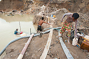Miners work in a huge illegal tin mine in Batako, Tunghin, that has completely devastated the once green landscape. Bangka Island (Indonesia) is devastated by a deadly tin rush, a direct consequence of the success of smartphones and tablets like iPhones and iPads from Apple or Samsung. The demand and price for tin has increased due to its use in smart phones and tablets.<br /> <br /> Des mineurs travaillent dans une grande mine d'étain illégale à Batako - Tunghin qui a complètement dévasté un paysage qui était autrefois verte. L'île de Bangka (Indonésie) est dévastée par des mines d'étain sauvages, une conséquence directe du succès des smartphones et tablettes comme les iPhones et les iPads d'Apple ou Samsung. La demande de l'étain a explosé à cause de son utilisation dans les smartphones et tablettes.