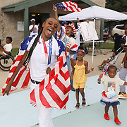 Oshae Jones and others get excited during a celebration in her honor at Rev. H. V. Savage Park in Toledo on Saturday, Aug. 21, 2021. She earned a bronze medal in the Tokyo Olympics in boxing. THE BLADE/KURT STEISS