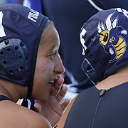 Katja Liebing/Sports Shooter Academy<br /> Fullerton's Gabbi Perez whispers to her team mate Marissa Vaccher at the Orange Empire Conference's Water Polo Championships at Saddleback College in Mission Viejo on Thursday, Nov. 3, 2016.