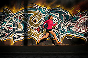 Ilucion Hernandez runs through the streets of Puebla City, Mexico