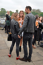 Centre & right, MILLIE MACKINTOSH and HUGO TAYLOR at a party to launch the Taylor Morris Explorer Collection held at the Serpentine Lido, Hyde Park, London on 11th May 2016.
