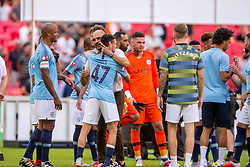 August 5, 2018 - Joseph Guardiola manager of Manchester City celebrates with Phil Foden of Manchester City during the 2018 FA Community Shield match between Chelsea and Manchester City at Wembley Stadium, London, England on 5 August 2018. (Credit Image: © AFP7 via ZUMA Wire)