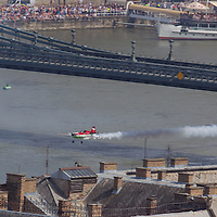 Aerobatic european champion Zoltan Veres of Hungary is seen flying under Chain Bridge with his airplane during an air show above river Danube crossing central Budapest, Hungary on May 01, 2013. ATTILA VOLGYI