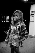 A young african american girl, lower Manhattan. New York City, 15 june 2010. Christian Mantuano / OneShot