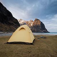 Wild tent camping at scenic Kvalvika beach, Moskenesøy, Lofoten Islands, Norway