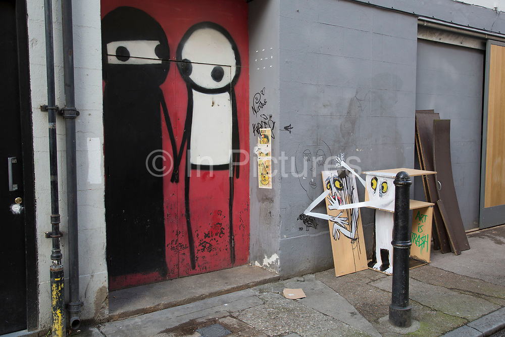Muslim and non muslim characters by the street artist Stik. His Stikmen appear all over the East End of London, UK. Here, just off Brick Lane a particularly culturally interesting Muslim character is seen. This area being mainly Bangladeshi, it seems particularly appropriate.