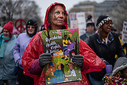 Women holding signs in the rain march at the 4th annual Woman's March rally supporting women rights on 01/18/2020. Photo by Akash Pamarthy
