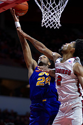 NORMAL, IL - December 31: Isaiah Brown reaches out for a lay up defended by Zach Copeland during a college basketball game between the ISU Redbirds and the University of Northern Iowa Panthers on December 31 2019 at Redbird Arena in Normal, IL. (Photo by Alan Look)