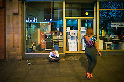 © Licensed to London News Pictures . 30/10/2016 . Manchester , UK . A man sits on the ground on Withy Grove . Revellers on a night out , many in fancy dress , on the weekend before Halloween . Photo credit : Joel Goodman/LNP