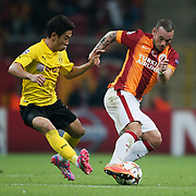 Galatasaray's Wesley Sneijder (R) and Borussia Dortmund's Shinji Kagawa (L) during their UEFA Champions League Group Stage Group D soccer match Galatasaray between Borussia Dortmund at the Ali Sami Yen Spor Kompleksi in Istanbul, Turkey on Wednesday 22 October 2014. Photo by Aykut AKICI/TURKPIX
