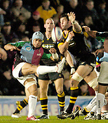 Wycombe. GREAT BRITAIN,  5th November 2004, Zurich Premiership Rugby,  London Wasps vs Harlequins, Adams Park, ENGLAND, [Mandatory Credit; Peter Spurrier/Intersport-images],<br /> Wasps Simon Shaw, reach's out, in an attempt, to block Steve So'Oialo's, clearance kick,<br /> <br /> [Mandatory Credit; Peter Spurrier/Intersport Images]
