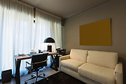 Elegant study with desk and a small sofa. Nobody inside