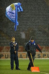 Groundsmen clear snow from the lines before  the first half of the match - Photo mandatory by-line: Rogan Thomson/JMP - Tel: Mobile: 07966 386802 18/01/2013 - SPORT - FOOTBALL - King Power Stadium - Leicester. Leicester City v Middlesbrough - npower Championship.
