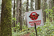 Signs warning visitors to follow rules in the Cerro Pelon Monarch Butterfly Preserve near Macheros, Michoacan, Mexico. The monarch butterfly migration is a phenomenon across North America, where the butterflies migrates each autumn to overwintering sites in Central Mexico.