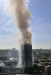 Smoke billows from a fire that has engulfed the 24-storey Grenfell Tower in west London.