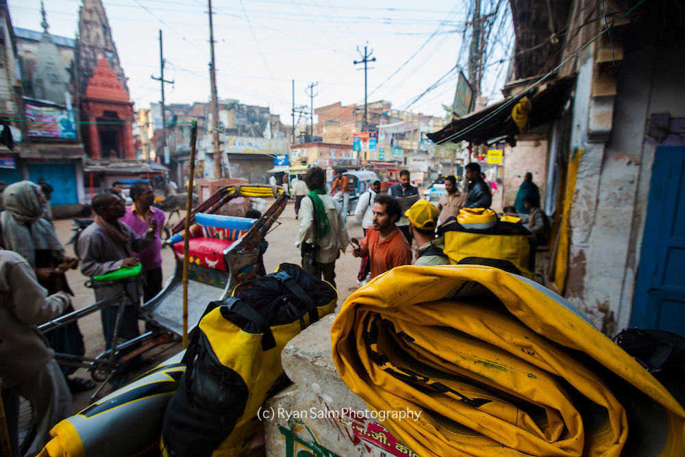 The crew waits to load up their gear on rickshaws.