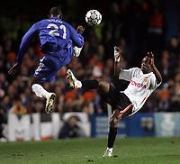 Photo: Paul Thomas.<br /> Chelsea v Valencia. UEFA Champions League. Quarter Final, 1st Leg. 04/04/2007.<br /> <br /> Soloman Kalou of Chelsea jumps in front of Luis Miguel (R).