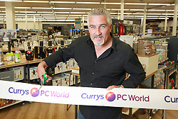 EDITORIAL USE ONLY Celebrity chef Paul Hollywood opens the Currys PC World megastore at Staples Corner Retail Park in London.