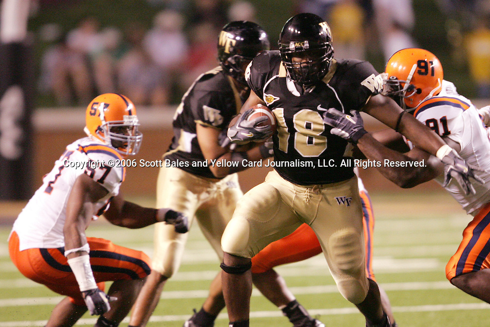 2 September 2006: Wake Forest's De'Angelo Bryant (18) breaks the tackle from Syracuse's Brandon Gilbeaux (91) and turns the corner. Wake Forest defeated Syracuse 20-10 at Groves Stadium in Winston-Salem, North Carolina in an NCAA college football game.