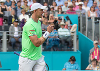Tennis - 2019 Queen's Club Fever-Tree Championships - Day One, Monday<br /> <br /> Men's Singles, First Round: Cameron Norrie (GBR) Vs. Kevin Anderson (RSA)  <br /> <br /> Kevin Anderson (RSA) celebrates his victory over Cameron Norrie (GBR) on Centre Court after 2 hours and 20 minutes <br />  <br /> COLORSPORT/DANIEL BEARHAM