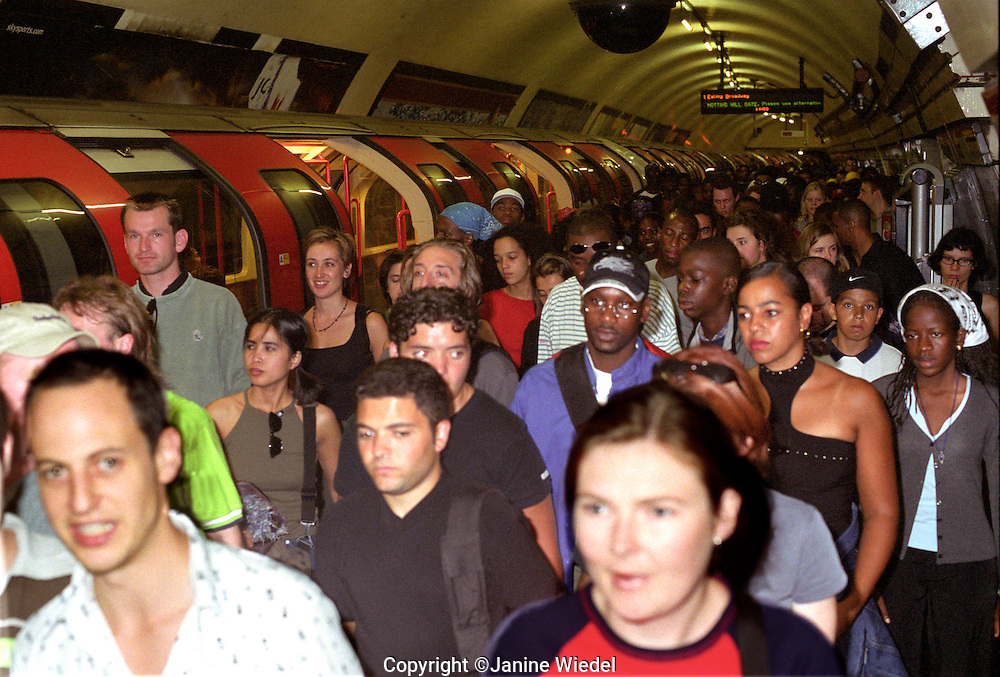 London underground at rush hour with commuters trying to get home.