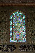 Stained Glass window and Iznik tiles in harem of Privy Chamber of Sultan Murad III, Topkapi Palace, Sarayi, Istanbul, Turkey
